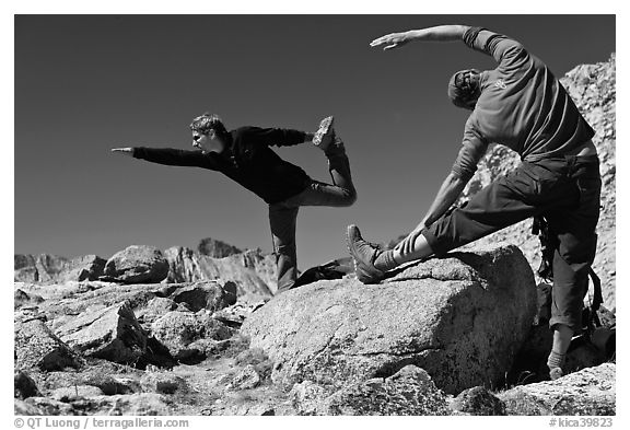 Hikers doing stretching exercises, Bishop Pass. Kings Canyon National Park, California