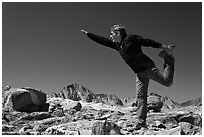 Hiker stretching, Bishop Pass. Kings Canyon National Park, California (black and white)