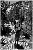 Crossing a river on a suspension bridge. Kings Canyon National Park, California (black and white)