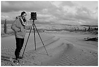 Large format photographer with camera on Kobuk Dunes. Kobuk Valley National Park, Alaska (black and white)