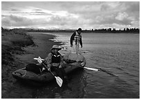Canoeists ready to lauch with the boat loaded up. Kobuk Valley National Park, Alaska (black and white)