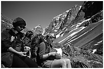 Women hikers pausing below the Telaquana Mountains. Lake Clark National Park, Alaska (black and white)