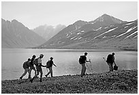 Group of hikers on the shores of Turquoise Lake. Lake Clark National Park, Alaska (black and white)