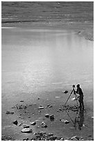 Large format photographer with tripod on the shores of Turquoise Lake. Lake Clark National Park, Alaska (black and white)