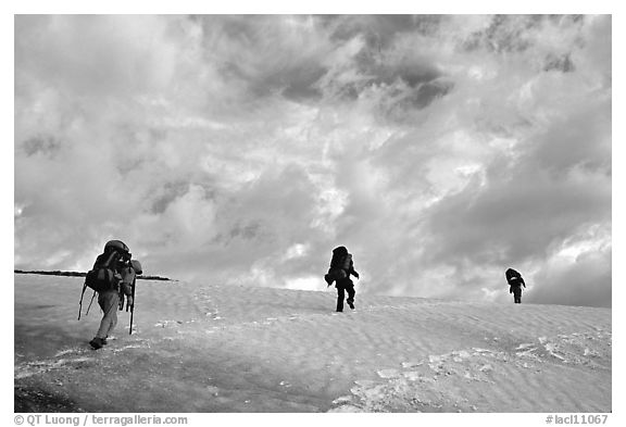 Backpackers crossing a neve. Lake Clark National Park, Alaska