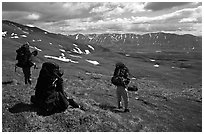 Backpackers take a pause when arriving on sight of Twin Lakes. Lake Clark National Park, Alaska (black and white)