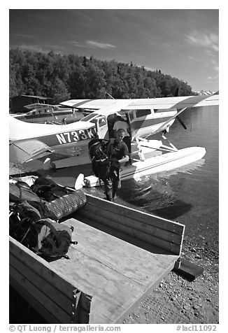 Backpackes being unloaded from floatplane in Port Alsworth. Lake Clark National Park, Alaska