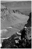 Woman gearing up to climb  East face of Mt Whitney. Sequoia National Park, California (black and white)