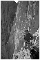 Man gearing up to climb  East face of Mt Whitney. Sequoia National Park, California (black and white)