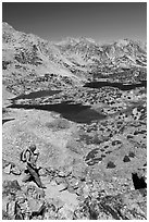 Hiker on trail above Saddlebag Lakes, John Muir Wilderness. Kings Canyon National Park, California (black and white)