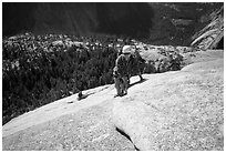 Rock climbers on the Snake Dike route, Half-Dome. Yosemite National Park, California (black and white)