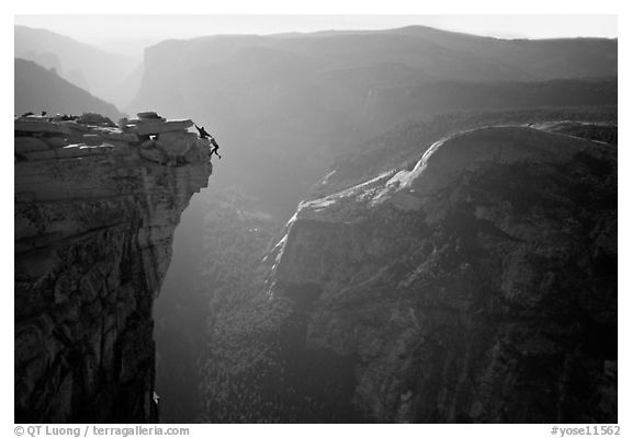 Hanging dramatically from the Jumping Board, Half-Dome. Yosemite National Park, California