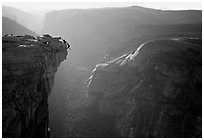 Hanging dramatically from the Jumping Board, Half-Dome. Yosemite National Park, California (black and white)