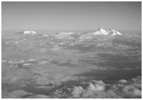 Summit of Mt Foraker and Mt Mc Kinley emerging from  clouds. Denali National Park, Alaska, USA. (black and white)