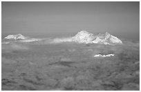 Mt Foraker and Mt Mc Kinley emerge from a sea of clouds. Denali National Park ( black and white)