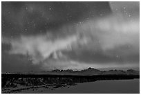 Aurora and stars above Alaska range. Denali National Park ( black and white)