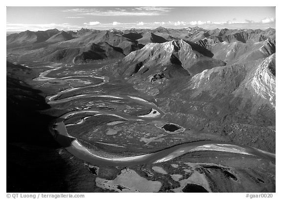 Aerial view of meandering Alatna river in mountain valley. Gates of the Arctic National Park (black and white)