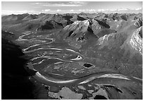 Aerial view of meandering Alatna river in mountain valley. Gates of the Arctic National Park, Alaska, USA. (black and white)