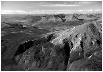 Aerial view of mountains with meandering Alatna river in the distance. Gates of the Arctic National Park, Alaska, USA. (black and white)