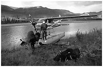 Backpackers beeing dropped off by a floatplane at Circle Lake. Gates of the Arctic National Park, Alaska (black and white)