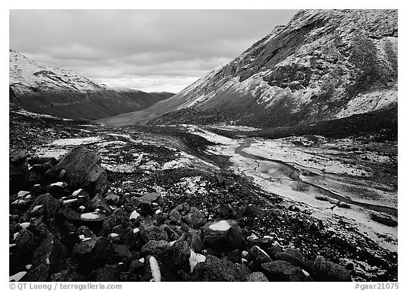 Boulders, valleys and slopes with fresh snow in cloudy weather. Gates of the Arctic National Park (black and white)