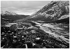 Boulders, valleys and slopes with fresh snow in cloudy weather. Gates of the Arctic National Park, Alaska, USA. (black and white)