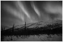 Colorful aurora curtains over Brooks Range. Gates of the Arctic National Park, Alaska, USA. (black and white)