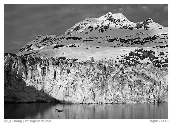 Face of Lamplugh Glacier illuminated by the sun on cloudy day. Glacier Bay National Park (black and white)