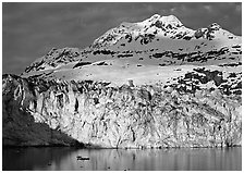 Face of Lamplugh Glacier illuminated by the sun on cloudy day. Glacier Bay National Park ( black and white)