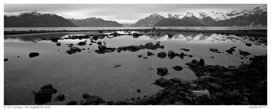 Blue scenery of water and mountains at dusk. Glacier Bay National Park (black and white)