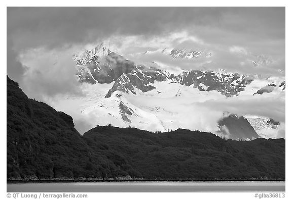 Dark ridge and cloud shrouded peaks, West Arm. Glacier Bay National Park (black and white)