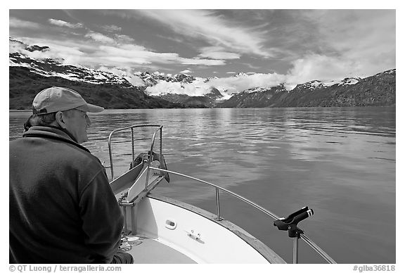 Man sitting at the bow of a small boat. Glacier Bay National Park (black and white)