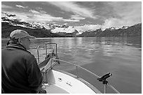 Man sitting at the bow of a small boat. Glacier Bay National Park, Alaska, USA. (black and white)