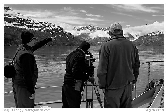 Crew filming from the deck of a boat. Glacier Bay National Park (black and white)
