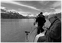 Film producer taking notes as crew films. Glacier Bay National Park ( black and white)