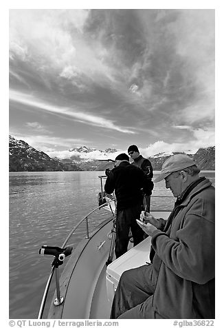 Movie producer taking notes as crew films. Glacier Bay National Park (black and white)