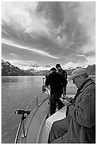 Movie producer taking notes as crew films. Glacier Bay National Park, Alaska, USA. (black and white)