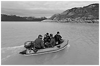 Film crew preparing for landing in a Zodiac. Glacier Bay National Park, Alaska, USA. (black and white)