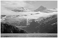 Rugged peaks of Fairweather range rising abruptly above the Bay. Glacier Bay National Park, Alaska, USA. (black and white)