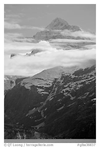 Pointed mountain with clouds hanging below. Glacier Bay National Park (black and white)