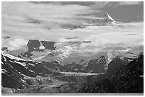 Pointed peaks of Fairweather range emerging from clouds. Glacier Bay National Park, Alaska, USA. (black and white)