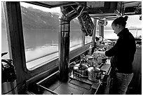 Chef preparing sadad in the main cabin of the Kahsteen. Glacier Bay National Park, Alaska, USA. (black and white)