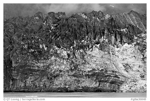 Ice colored by black moraining debris on the front of Margerie Glacier. Glacier Bay National Park (black and white)
