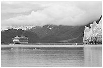 Cruise boat in Tarr Inlet next to Margerie Glacier. Glacier Bay National Park, Alaska, USA. (black and white)