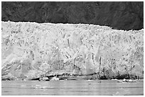Small tour boat dwarfed by Margerie Glacier. Glacier Bay National Park, Alaska, USA. (black and white)