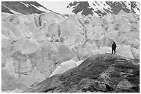 Hiker on a hill below Reid Glacier. Glacier Bay National Park ( black and white)