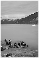 Film crew embarking on a skiff after shore excursion. Glacier Bay National Park ( black and white)