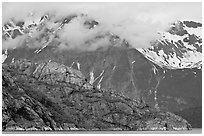 Rocky ridge and snowy peaks, West Arm. Glacier Bay National Park, Alaska, USA. (black and white)