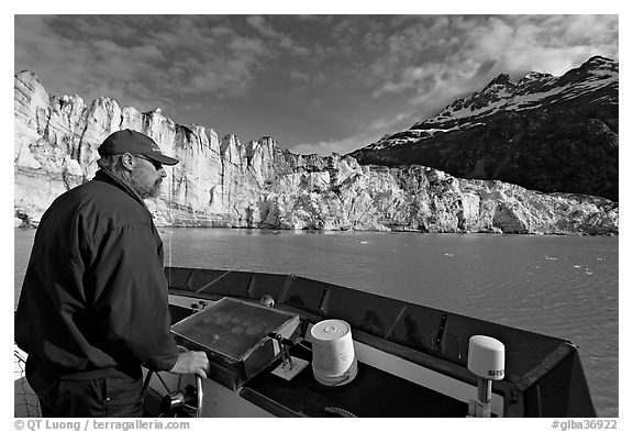 Captain guiding boat near Lamplugh glacier. Glacier Bay National Park (black and white)