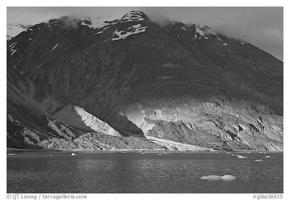 Sunset light falling on the base of the peaks around Tarr Inlet. Glacier Bay National Park (black and white)